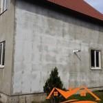Нанесение штукатурки на дом из сип панелей
